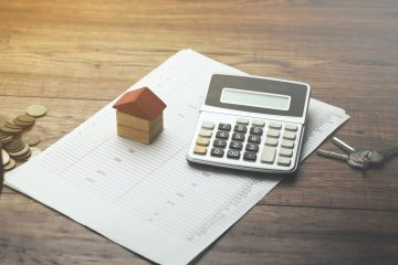 home sales, house,calculator and key on document